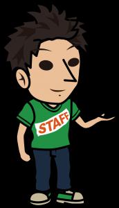 笑顔で案内する緑のスタッフTシャツの男性「とびぃ」