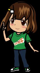 人差し指を立てる緑のスタッフTシャツの女性「むこりん」